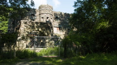 Abandoned Castle entryway in woods, stone structure - stock footage