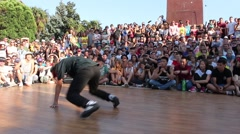 Break dancing team show their talents on the streets of city Stock Footage