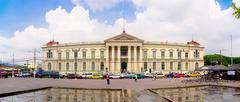 San Salvador, El Salvador - Presidential Palace with traffic jam - stock photo