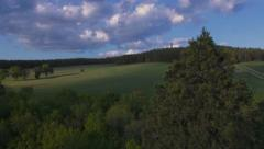 Aerial flight over Trees as the sun sets, Scottish Borders. Stock Footage