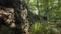 Old Stone Wall in woods of New England, rock wall structure Stock Footage