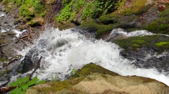 Waterfall in the mountains near the village Pylypets, Carpathians (slow motion) - stock footage