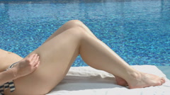 Rich woman with hot body enjoying rest near pool at luxury hotel Stock Footage