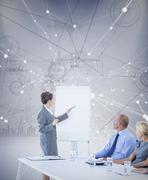 Composite image of business people looking at meeting board during conference Stock Photos