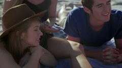 Teenagers hangout at the beach Stock Footage