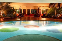 The swimming pool at luxury hotel in night illumination, Ajman, UAE - stock photo