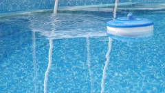 Stock Video Footage of Pool maintenance - float with the preparation for water treatment