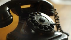 Dialing with an retro rotary phone - Includes audio dial phone - stock footage