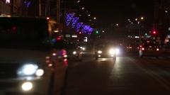 Cars going on street at dark winter night - stock footage