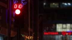Traffic lights with timer near building at dark night in city Stock Footage