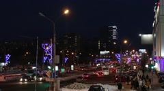Cars and people going on street at winter night in city - stock footage