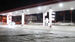 Car comes to petrol station and refuel at night in winter. Time lapse Stock Footage