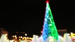 Christmas tree with illumination outdoor at winter night out of focus - stock footage