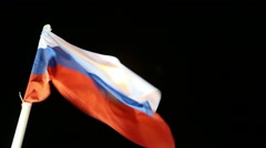 Flags of Russia with illumination on wind at dark night - stock footage