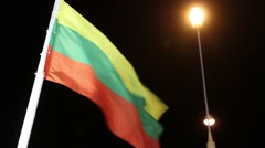 Flags of Lithuania with illumination on wind at dark night Stock Footage