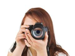 Woman with camera and eye in lens Stock Photos