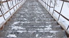 Frozen metal old staircase in snow in winter outdoor Stock Footage