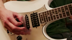 Hands of young man playing white guitar Stock Footage