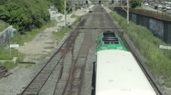High angle two commuter trains passing afternoon - stock footage