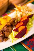 fritada, fried pork, traditional ecuatorian dish - stock photo
