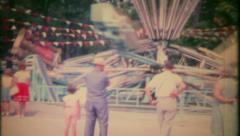 2358 - the crowd enjoys rides at local carnival - vintage film home movie Stock Footage
