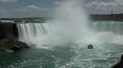 Boat tour into Niagara Falls in 4K Stock Footage