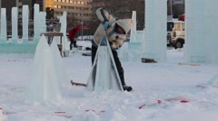 Men make ice sculptures for Ice town Stock Footage