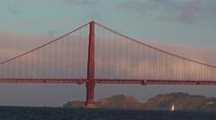 Sail boat sail under the Golden Gate Bridge in San Francisco, CA Stock Footage