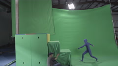 Slow motion green screen shot of woman mimicking a ninja climbing a structure Stock Footage