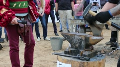 Blacksmith beats at International Festival Sarong Crucible Stock Footage