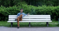 Two men smoke in the park. Stock Footage