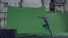 Slow motion green screen shot of man performing stunt Stock Footage