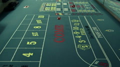 Dice rolling across a craps table. Stock Footage