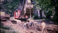 2359 excavator at work at construction site - vintage film home movie Stock Footage
