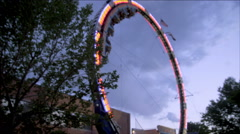 Stock Video Footage of Shot of circular rollercoaster swaying back and forth.