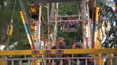 Shot of a boy and a girl getting off of a carnival ride. Stock Footage
