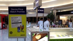 One side of telus sales booth inside shopping mall Stock Footage