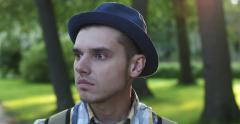 Men's emotions on the background of the park. Sadness. Stock Footage