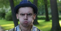 Men's emotions on the background of the park. Affectation. Stock Footage