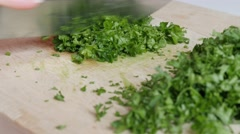 Fresh persil vegetable plant cutting with knife on smaller pieces 4K 3840X216 Stock Footage