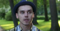 Men's emotions on the background of the park. Anxiety. Stock Footage