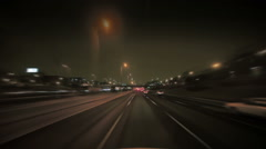 Vehicle travels at night Stock Footage