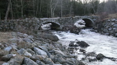 Small river under stone bridge Stock Footage