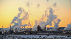 Distant Smoke Stacks during Sunset Stock Footage