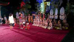 Tourists take pictures with theatre troupe after Balinese night performance Stock Footage