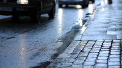 Tilting shot of cobbled sidewalk and oncoming traffic on a street in Copenhagen, Stock Footage