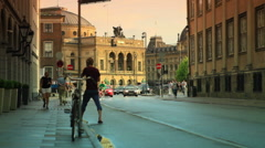 Static shot of oncoming traffic on a street in Copenhagen, Denmark Stock Footage
