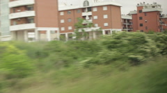 Italian houses and greenery from a train Stock Footage