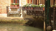 Flower boxes on a canal Stock Footage