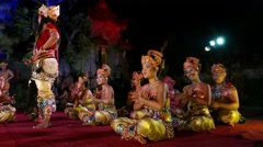 Night performance, Balinese woman sit and sway on stage, smile and sing Stock Footage